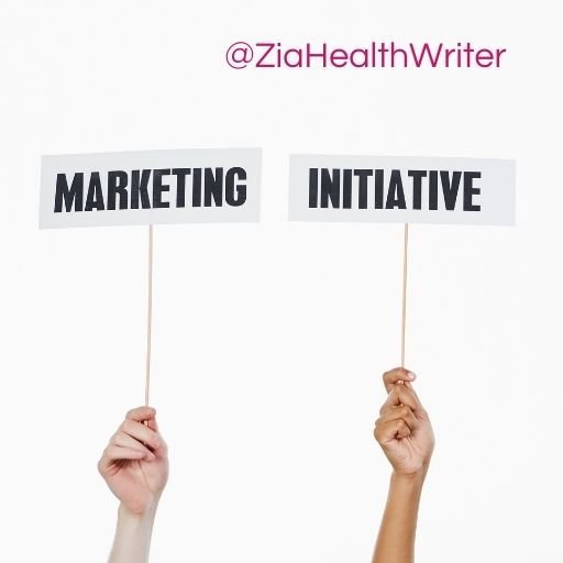 """image of two hands holding signs. One signs read"""" marketing"""", the other reads """"initiative"""""""