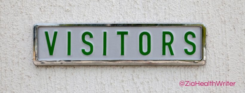 """Image of a registration plate on a wall. The registration plate says """"Visitors"""""""