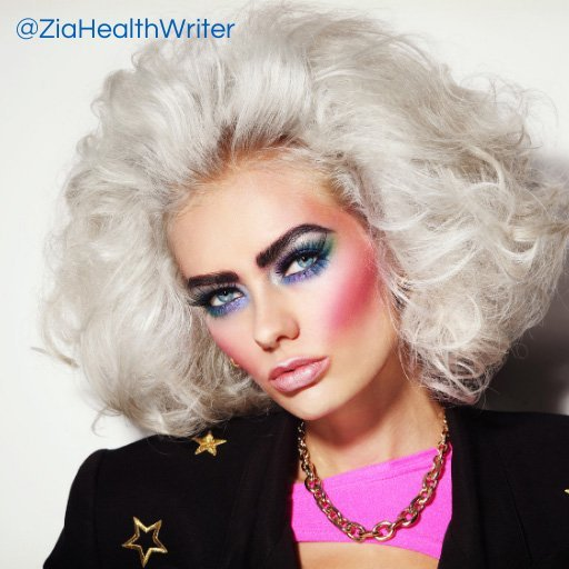 image of a female head and shoulders sporting an 80's punk rock look