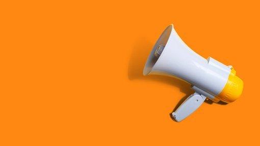 Image of a megaphone on an orange background