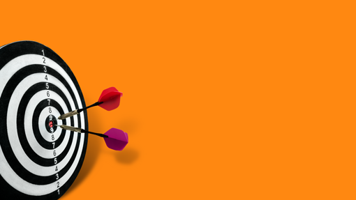 Image of a dartboard and 2 darts in the bullseye on an orange background