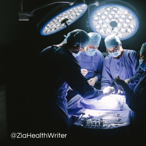 Image of 4 surgeons at the operating table