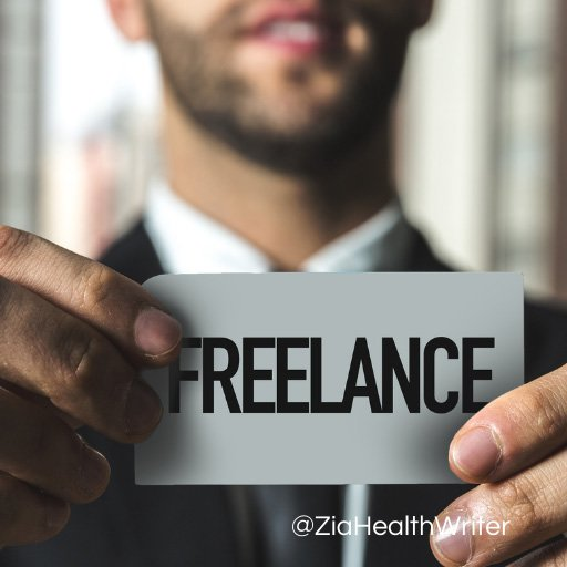 man holding a card that reads freelance