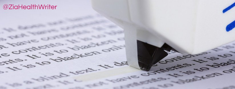 image of some tippex white out being applied to a typed document