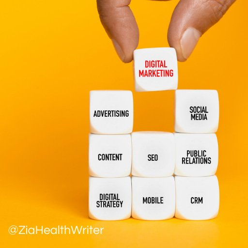 image of cubes with marketing words written on them in a stack. a hand is selecting a cube that says digital marketing